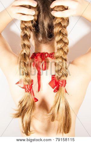 A young beautiful girl with long tresses