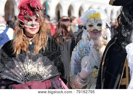 Masked Woman Walking In Venice