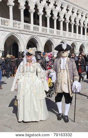 Masked Couple Walking In Venice