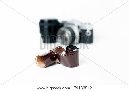 Analog Photo Reel With Camera In Background