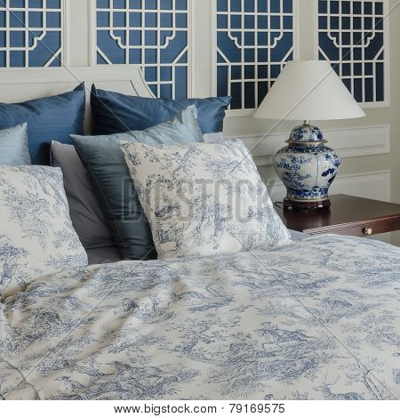 Pillows On Luxury King Size Bed In Bedroom At Home
