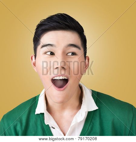 Funny facial expression, closeup Asian young man.