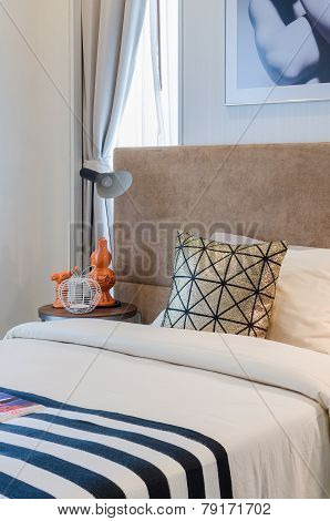 Single Bed With Pillows In Bedroom