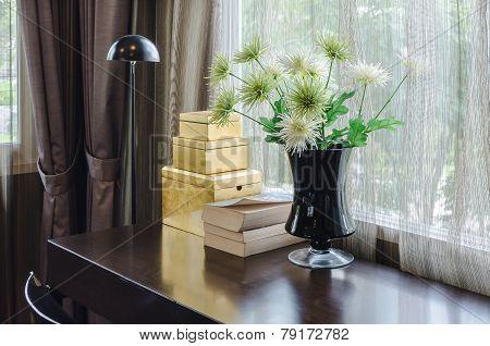Flower In Black Vase On Wooden Table