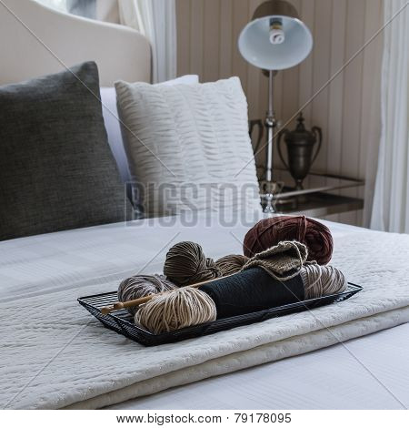 Wood Tray Of Crochet On Bed