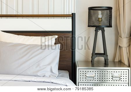 Pillows On Bed With Modern Lamp