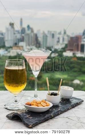 Glass Of Beer And Cocktail With Snack