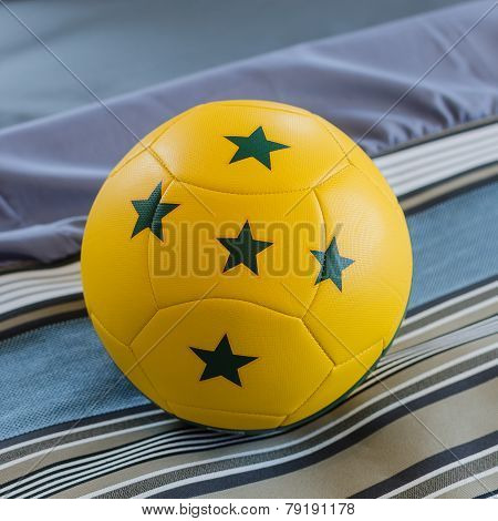 Yellow Ball With Green Five Star On Bed