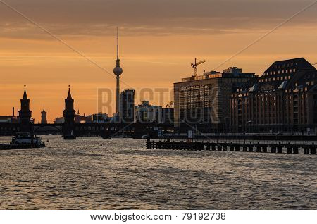 Berlin Oberbaumbrucke With Tv Tower At Sunset