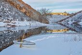 foto of horsetooth reservoir  - decked expedition canoe on icy shore  of Horsetooth Reservoir near Fort Collins in northern Colorado - JPG