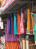 stock photo of charminar  - Fine silk brocade saree fabric in Lad Bazaar in Charminar Hyderabad Andhra Pradesh India Asia - JPG
