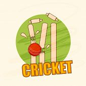 stock photo of cricket ball  - Cricket wicket stumps cracked by red ball on stylish green background - JPG