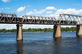 picture of railcar  - Petrivskiy railroad bridge in Kyiv across the Dnieper with freight train on it - JPG
