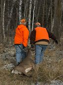 pic of hunter  - A pair of deer hunters with a White - JPG