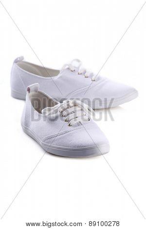 WStudio shot of white sneakers