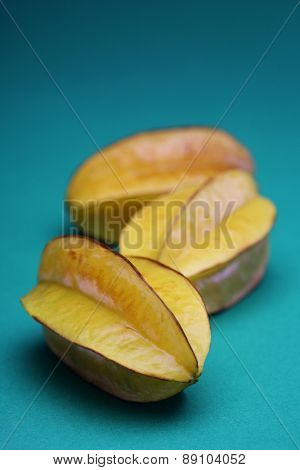 Carambola fruit on blue background