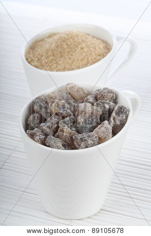 Brown sugar in white cups