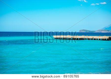 Seascape with concrete pier