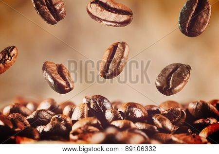 roasted coffee beans is falling down, warm colors toned