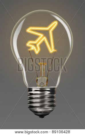 bulb with glowing airplane inside of it, creativity concept