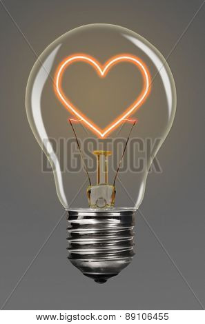 bulb with glowing red heart inside of it, creativity concept
