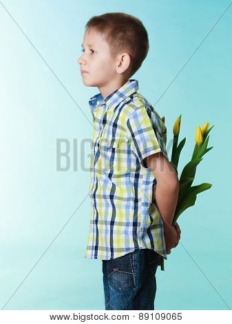 Boy Hiding Bouquet Of Flowers Behind Itself