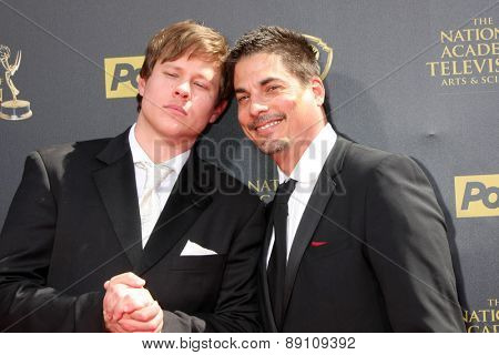 LOS ANGELES - APR 26:  Guy Wilson, Bryan Dattilo at the 2015 Daytime Emmy Awards at the Warner Brothers Studio Lot on April 26, 2015 in Burbank, CA