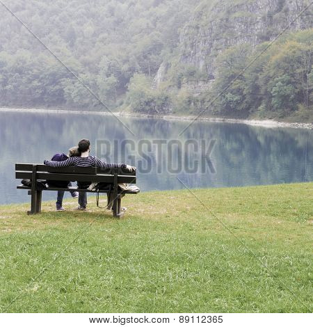 Lovers On The Bench In Front Of The Lake