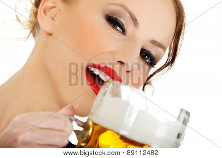 Beautiful bavarian woman drinking beer.