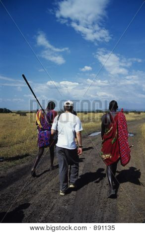 Tourist With Maasai Warriors