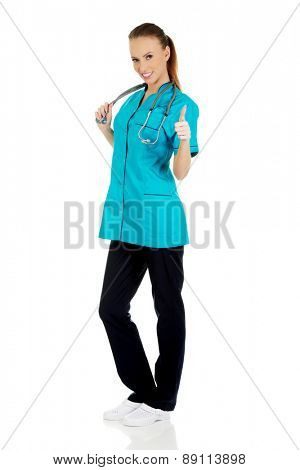 Beautiful smiling woman doctor with thumbs up.