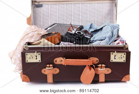 Packing suitcase for trip isolated on white