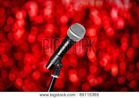 Microphone on stand on red background
