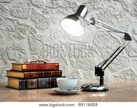 Vintage books coffee cup and desk lamp on the table. Place of work.  3d