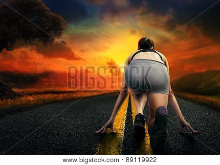 Girl Athlete Running On The Road