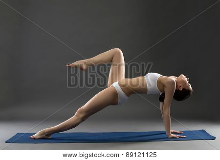 Image of yoga instructor exercising in studio