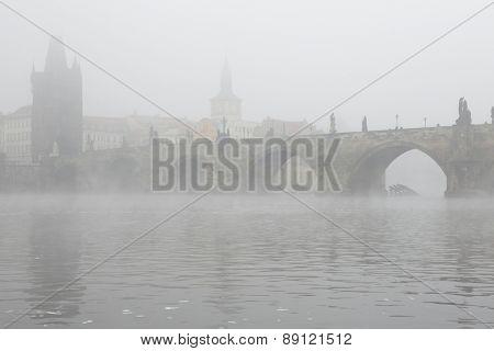 Morning fog over the Charles Bridge in Prague, Czech Republic.