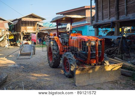 local's house with a big  tractor