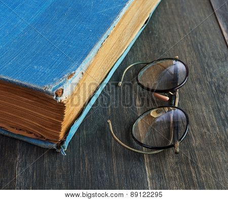 Retro Glasses And Old Book