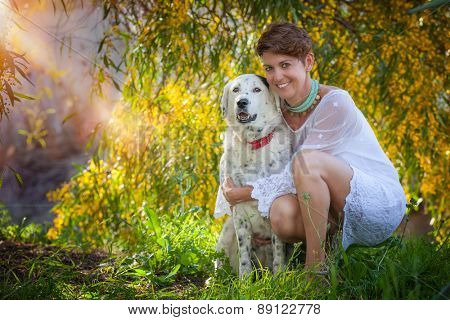 family pet mongrel dog outdoors with female owner