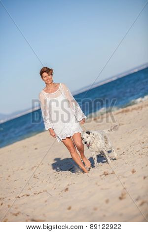 walking old rescue dog on beach