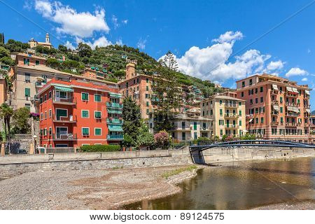 Colorful houses under blue sky in town of Recco, Italy.