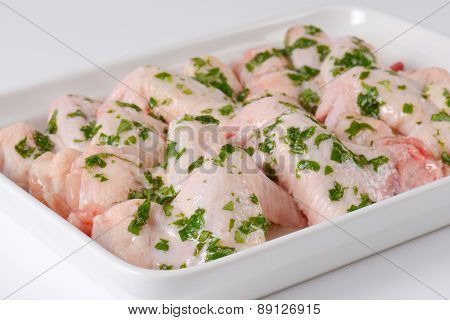 detail of chicken legs with herb marinade, in the tray
