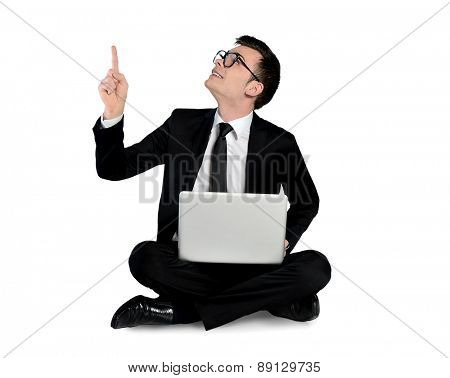Isolated business man pointing up