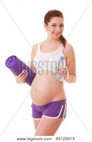 Beautiful pregnant woman with exercising mat and water on white background