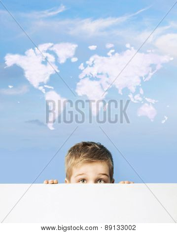 Small boy and cloud world map
