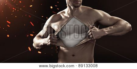 A muscular man pulling his chest skin away