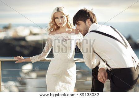 Romantic wedding couple on sea-coast