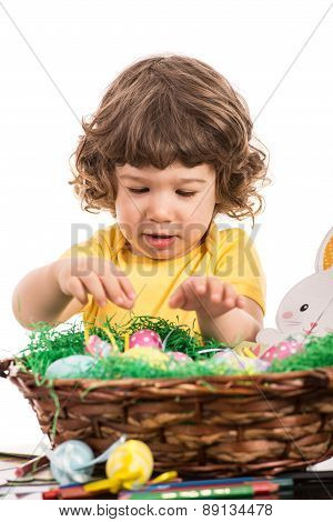 Toddler Boy Arrange Easter Eggs In Basket