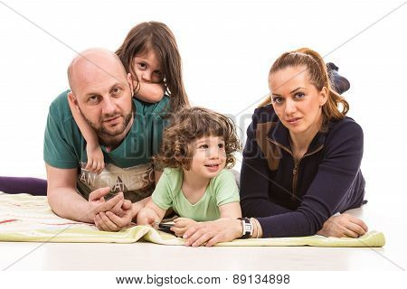 Cheerful Family With Two Kids
